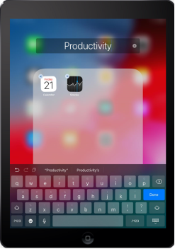 The newly created folder is named Productivity. The folder contains two apps: Stocks and Calendar.